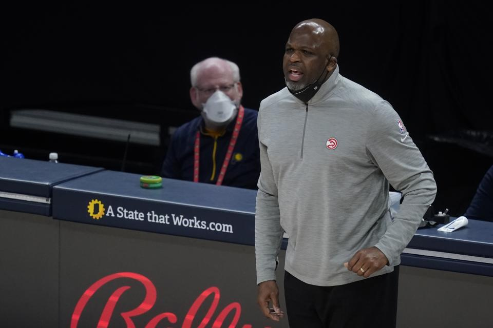 Atlanta Hawks head coach Nate McMillan in action during the first half of an NBA basketball game against the Indiana Pacers, Thursday, May 6, 2021, in Indianapolis. (AP Photo/Darron Cummings)