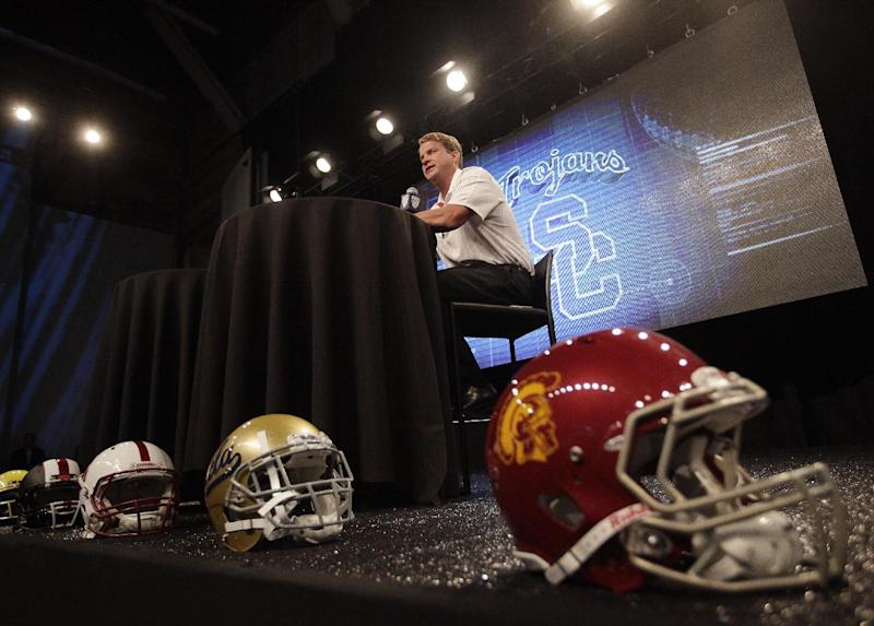 Southern California head coach Lane Kiffin talks to the media during the NCAA college football Pac-12 media day on Friday, July 26, 2013, in Culver City, Calif. (AP Photo/Jae C. Hong)