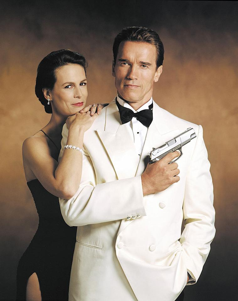 """In 1994's """"True Lies,"""" Arnold Schwarzenegger and Jamie Lee Curtis starred as a couple whose boring life together was threatening to ruin their marriage, at least until the wife found out her husband had been hiding a secret: he was an undercover spy for the United States government! Suddenly, that fight over who should do the dishes didn't seem like such a big deal anymore. © 20th Century Fox Film Corp./Courtesy: Everett Collection."""