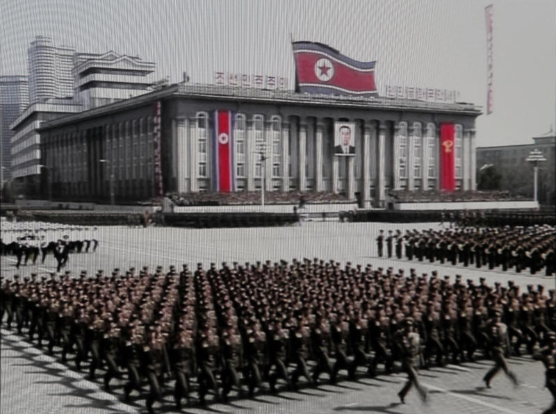 In this image made from KRT video, North Korean military soldiers march during a massive celebration marking the 100th birthday of national founder Kim Il Sung, at Kim Il Sung square in Pyongyang, North Korea. North Korean leader Kim Jong Un has spoken publicly for the first time at the celebration. (AP Photo/KRT via AP video) NORTH KOREA OUT, TV OUT