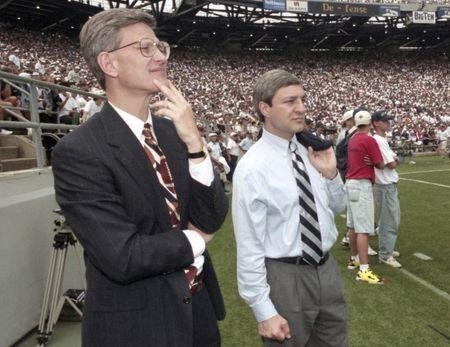Penn State athletic director Tim Curley (L) and Penn State president Graham Spanier watch the Nittany Lions' football game against Texas Tech from the sidelines of Beaver Stadium in State College, Pennsylvania in this September 9, 1995 file photo.  REUTERS/Craig Houtz/Files