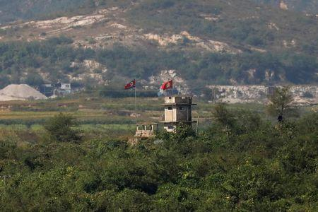 FILE PHOTO: A North Korean flag flutters at a guard post near the propaganda village of Gijungdong in North Korea, in this picture taken near the truce village of Panmunjom, South Korea, September 28, 2017. REUTERS/Kim Hong-Ji