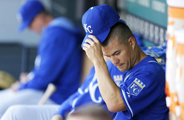 Kansas City Royals starting pitcher Jeremy Guthrie removes his cap in the dugout after being pulled from a baseball game against the Seattle Mariners in the fifth inning, Sunday, May 11, 2014 in Seattle. (AP Photo/Ted S. Warren)