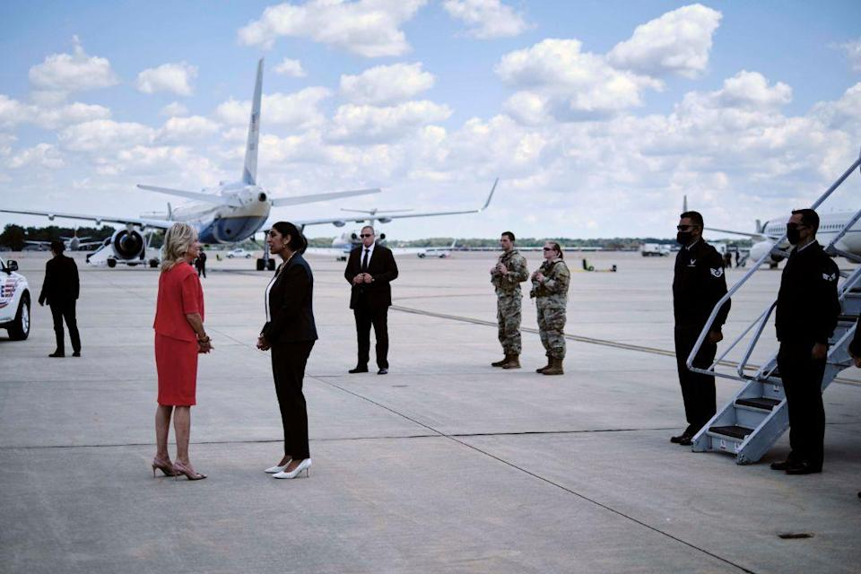 First lady Jill Biden and Dr. Anthony Fauci, director of the National Institute of Allergy and Infectious Diseases, arrive at Orlando International Airport in Orlando, Fla., Thursday, June 24. - Credit: AP