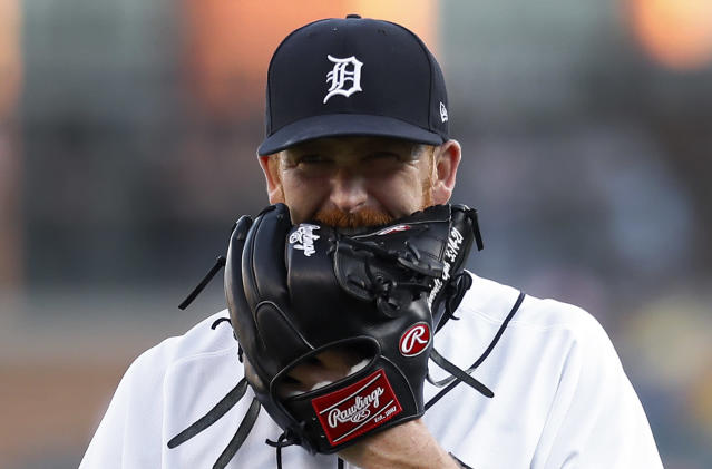 Detroit Tigers pitcher Spencer Turnbull bites his glove on the way to the dugout against the Chicago White Sox in the first inning of a baseball game in Detroit, Monday, Aug. 5, 2019. (AP Photo/Paul Sancya)