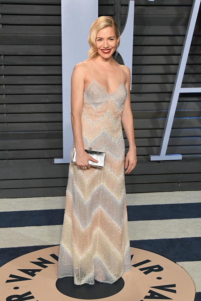 <p>The British actress opted for a chevron print in a soft neutral palette. (Photo: Jon Kopaloff/WireImage) </p>