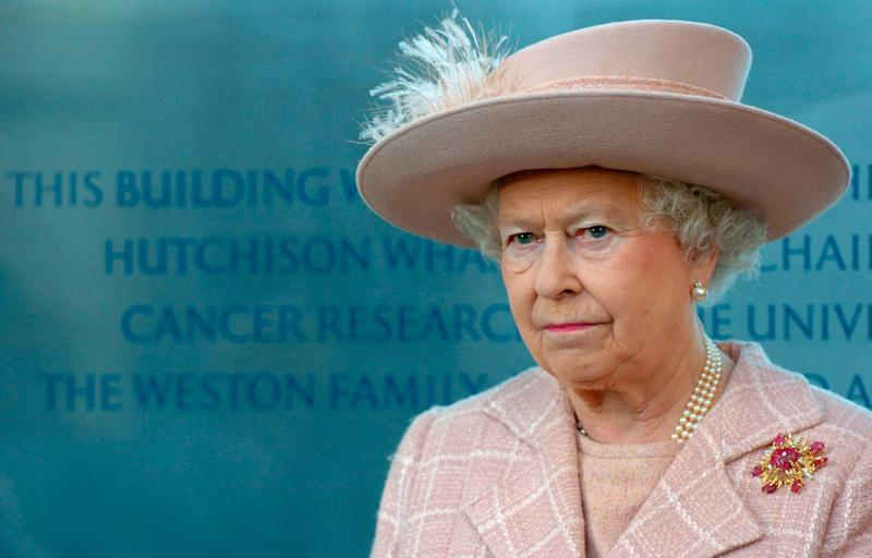 Queen Elizabeth wearing a pink hat