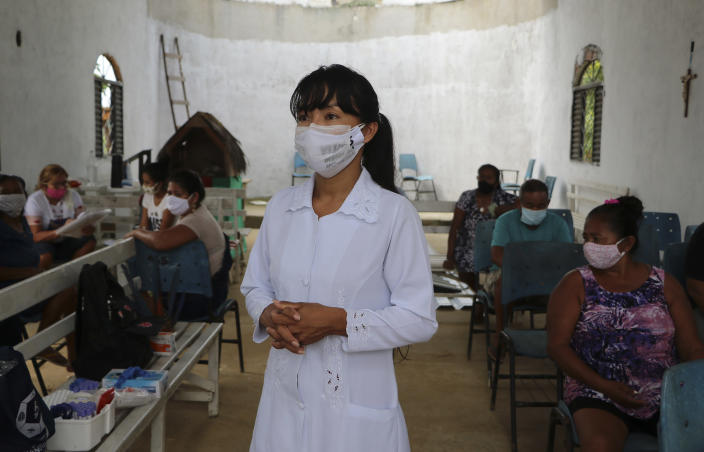 "Health worker Vanda Ortega from the Witoto Indigenous group stands during a COVID-19 testing drive at the Indigenous Park, a tribal community in the outskirts of Manaus, Amazonas state, Brazil, Thursday, Jan. 7, 2021. Medical teams are scrambling to assist indigenous people living in outlying areas of Manaus, where medical care is scarce after authorities issued a ""State of Emergency"" due to rising numbers of infection numbers in Amazonas State. (AP Photo/Edmar Barros)"
