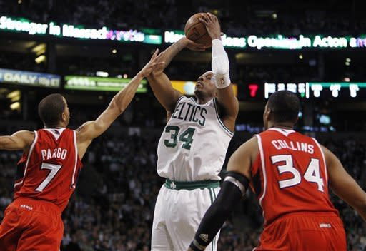 Boston Celtics' Paul Pierce, center, shoots between Atlanta Hawks' Jannero Pargo (7) and Jason Collins during the second quarter of Game 4 of an NBA basketball first-round playoff series, in Boston on Sunday, May 6, 2012. (AP Photo/Michael Dwyer)