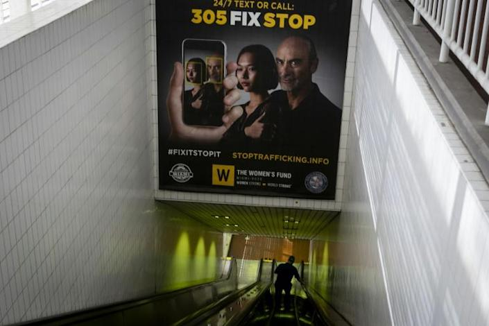 Billboards displaying a campaign against human trafficking are seen at Knight Center Metrorail station in Downtown Miami on January 9, 2020 (AFP Photo/Eva Marie UZCATEGUI)