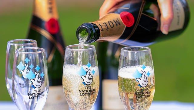 A bottle of Moet & Chandon champagne with The National Lottery branded champagne flutes (Peter Byrne/PA)