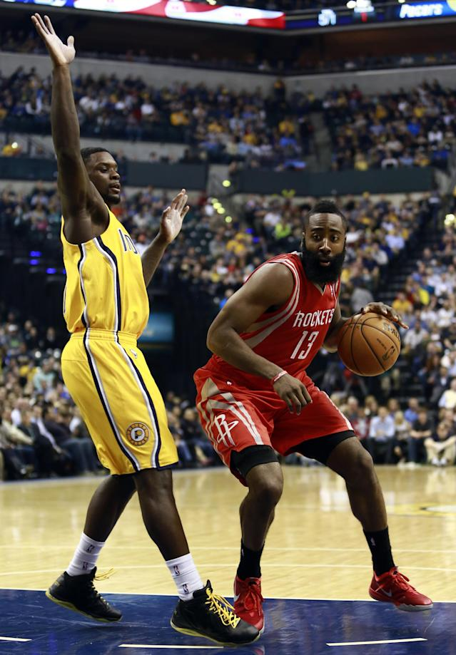 Houston Rockets guard James Harden (13) moves by Indiana Pacers guard Lance Stephenson in the first half of an NBA basketball game in Indianapolis, Friday, Dec. 20, 2013. (AP Photo/R Brent Smith)