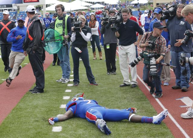 Kansas running back Tony Pierson (3) lies injured on the sidelines during the second half of an NCAA college football game against Texas Tech in Lawrence, Kan., Saturday, Oct. 5, 2013. (AP Photo/Orlin Wagner)