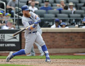 Los Angeles Dodgers' Justin Turner hits a solo home run during the 11th inning of a baseball game against the New York Mets at Citi Field, Sunday, June 24, 2018, in New York. (AP Photo/Seth Wenig)