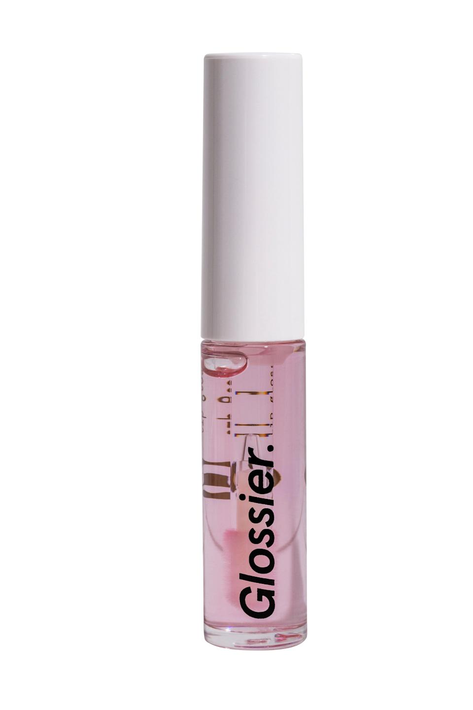 """<h3>Lip Gloss<br></h3> <br>A perfectly nice clear, non-sticky gloss that leaves lips hydrated and adds just the right amount of sexy sheen. It's not the most innovative, or the most affordable — but it does look good, so if you're committed to that aesthetically-pleasing Glossier lifestyle, this is one tube you'll probably want to keep at your desk for any Instagram opportunities.<br><br><strong>Glossier</strong> Lip Gloss, $, available at <a href=""""https://go.skimresources.com/?id=30283X879131&url=https%3A%2F%2Fglossier.sjv.io%2FEgYjQ"""" rel=""""nofollow noopener"""" target=""""_blank"""" data-ylk=""""slk:Glossier"""" class=""""link rapid-noclick-resp"""">Glossier</a><br>"""