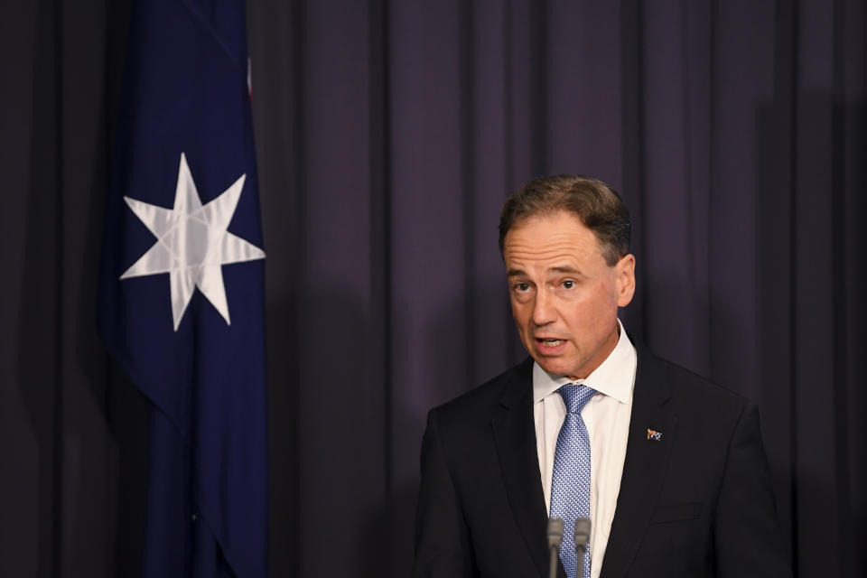 Australian Health Minister Greg Hunt said Australians defying the ban could be hit with a $66,600 fine or five years in prison, or both. Source: AAP