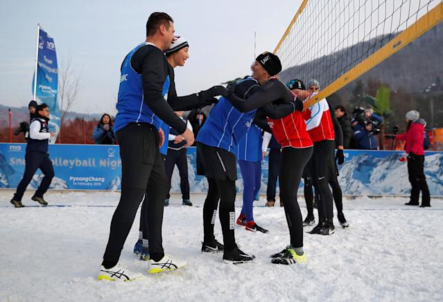 Pyeongchang 2018 Winter Olympics - Pyeongchang - South Korea – February 14, 2018. Players hug each other during an event promoting the Snow Volleyball hosted by the International Volleyball Federation (FIVB) and European Volleyball Confederation (CEV) in Pyeongchang. REUTERS/Kim Hong-Ji
