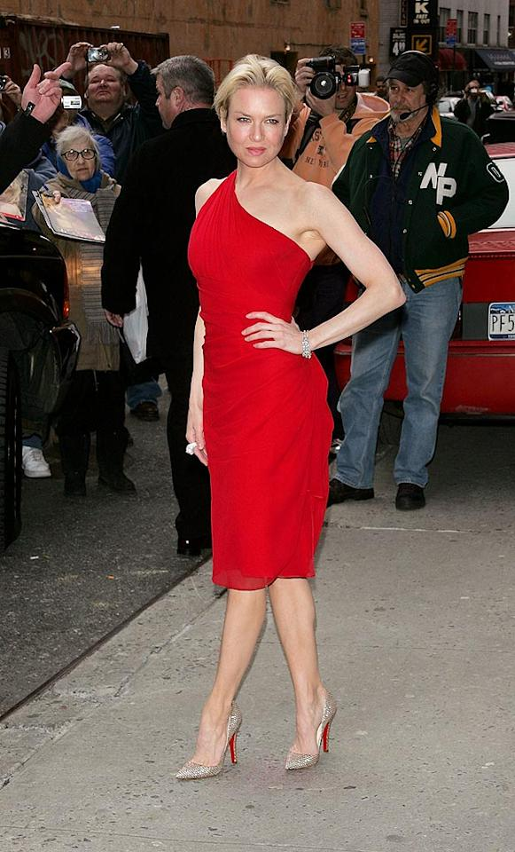 "Renee Zellweger stops traffic on the streets of NYC in her one-shoulder crimson dress. Jim Spellman/<a href=""http://www.wireimage.com"" target=""new"">WireImage.com</a> - April 3, 2008"