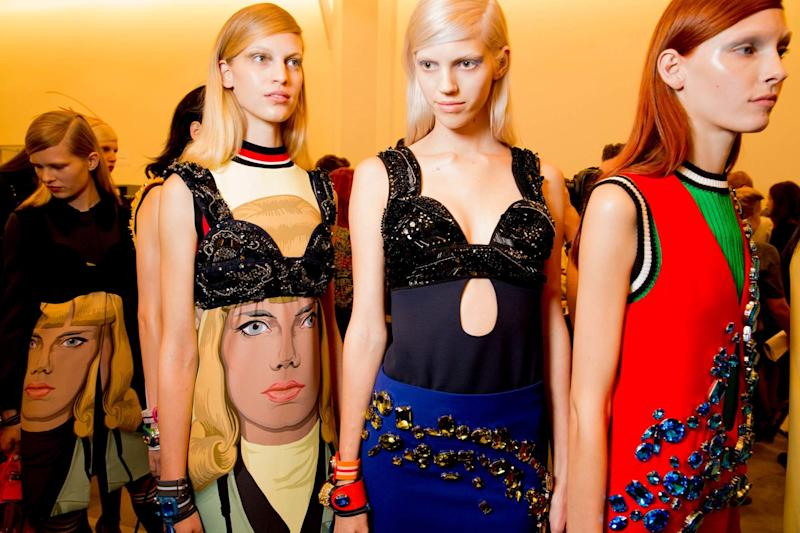 Like the bold color blocking in Miuccia's Spring 2014 collection, Prada's model gang sat for saturated, single-tone dye jobs that made highlights seem obsolete. Auburn, raven, and peroxide manes were pinned back and paired with bleached brows for a wholly contemporary look.