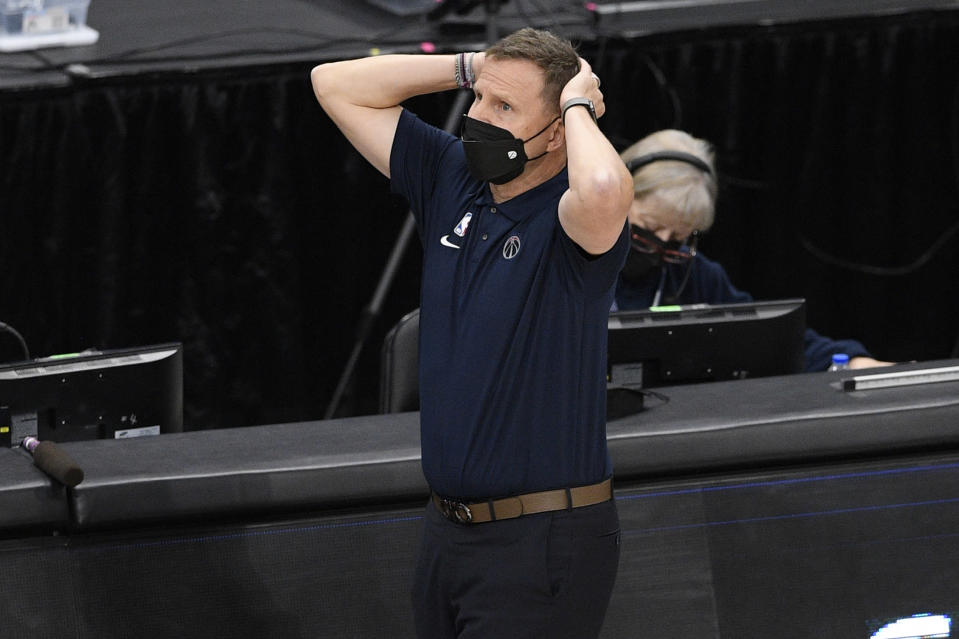 Washington Wizards head coach Scott Brooks react during the second half of an NBA basketball game against the Charlotte Hornets, Sunday, May 16, 2021, in Washington. (AP Photo/Nick Wass)
