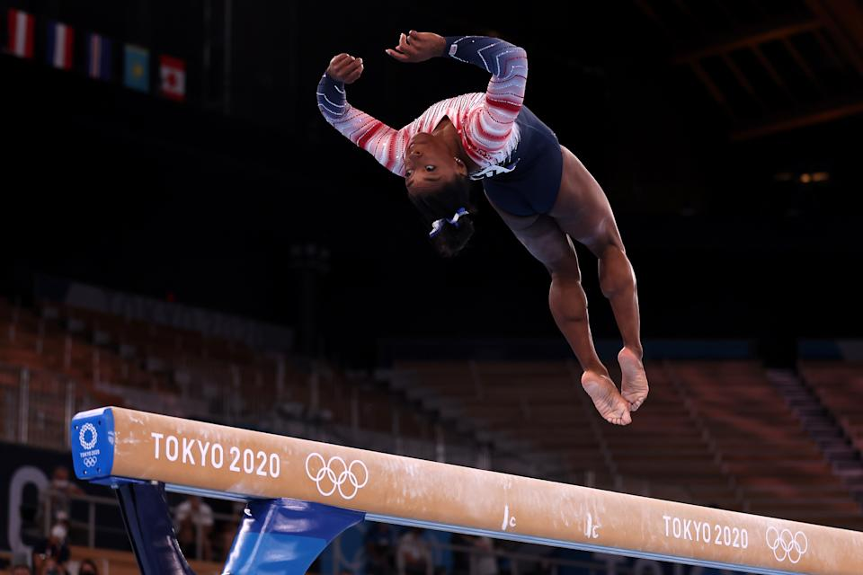 Simone Biles of the United States competes in the women's balance beam final at the 2020 Tokyo Olympics.