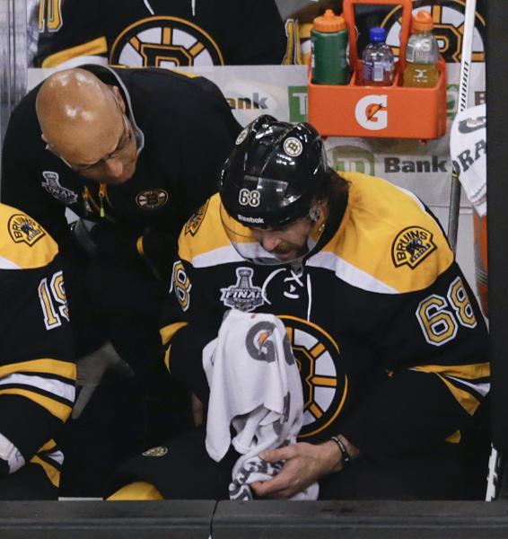 Boston Bruins right wing Jaromir Jagr (68), of the Czech Republic, is tended on the bench during the first period in Game 6 of the NHL hockey Stanley Cup Finals against the Chicago Blackhawks, Monday, June 24, 2013, in Boston. (AP Photo/Charles Krupa)