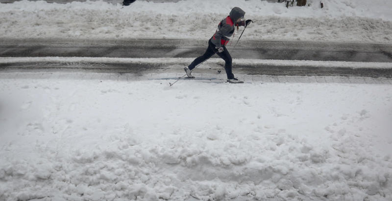A cross-country skier glides on slushy snow on Brooklyn's Livingston Street, Tuesday March 14, 2017, in New York. (AP Photo/Bebeto Matthews)