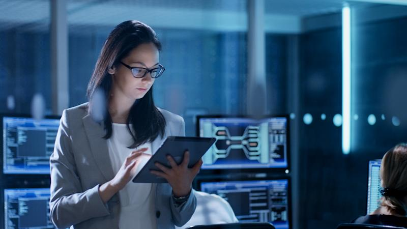 Woman with tablet in server room