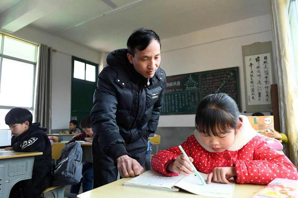 Typically, Chinese primary school pupils take extracurricular tutoring on top of their studies on campus.  Photo: Xinhua