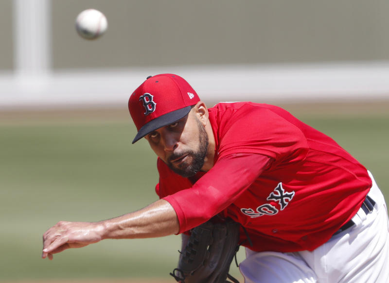Boston Red Sox starting pitcher David Price delivers a pitch in the second inning of a spring training baseball game against the Detroit Tigers, Tuesday, March 12, 2019, in Fort Myers, Fla. (AP Photo/John Bazemore)