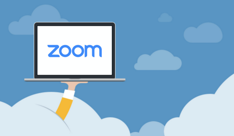 Arm poking through cloud holding up laptop computer with Zoom logo on its screen.