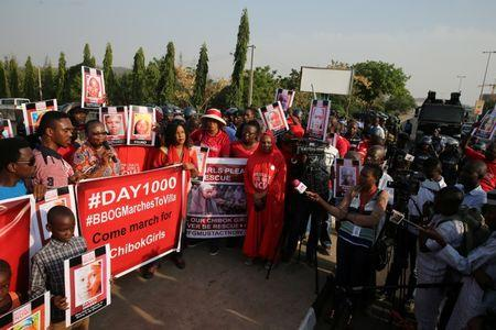 Police disrupt a rally by the #BringBackOurGirls campaign, which is protesting in Nigeria's capital Abuja to mark 1,000 days since over 200 schoolgirls were kidnapped from their secondary school in Chibok by Islamist sect Boko Haram, Nigeria