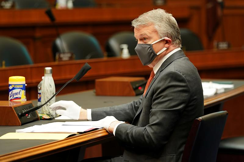 Richard Bright, former director of the Biomedical Advanced Research and Development Authority, wears a face mask during testimony