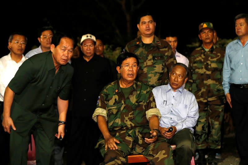 Cambodia PM Hun Sen visits the site where a building being under construction collapsed in Kep