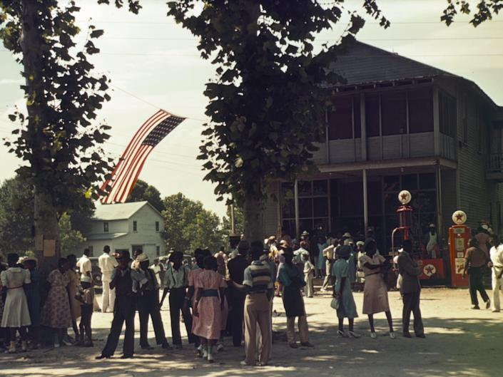 People gather in the street to celebrate July 4 in St Helena Island, South Carolina, in 1939.