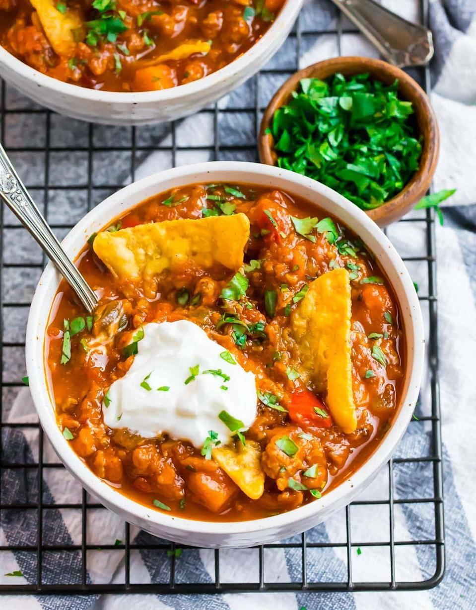"""<p>Ground turkey is a lean choice for this pumpkin chili but you can easily swap in ground chicken or beef instead. Top it off with whatever garnishes you like best: Try jalapeño, avocado, cilantro, or chips!</p><p><strong>Get the recipe at <a href=""""https://www.wellplated.com/pumpkin-chili/"""" rel=""""nofollow noopener"""" target=""""_blank"""" data-ylk=""""slk:Well Plated by Erin"""" class=""""link rapid-noclick-resp"""">Well Plated by Erin</a>. </strong></p><p><a class=""""link rapid-noclick-resp"""" href=""""https://go.redirectingat.com?id=74968X1596630&url=https%3A%2F%2Fwww.walmart.com%2Fsearch%2F%3Fquery%3Dpioneer%2Bwoman%2Bcooking%2Btools&sref=https%3A%2F%2Fwww.thepioneerwoman.com%2Ffood-cooking%2Fmeals-menus%2Fg37022645%2Fhealthy-pumpkin-recipes%2F"""" rel=""""nofollow noopener"""" target=""""_blank"""" data-ylk=""""slk:SHOP COOKING TOOLS"""">SHOP COOKING TOOLS</a></p>"""