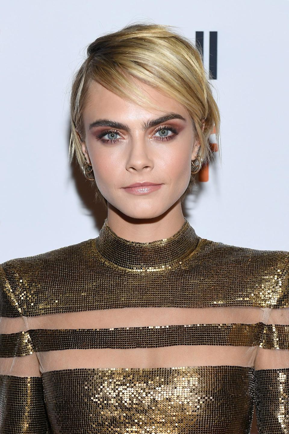 <p>Delevingne defied the awkward grow-out phase with a brighter shade of blond and a choppy, layered pixie cut.</p>