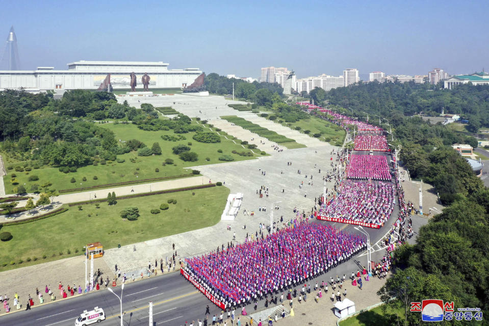 """In this photo provided by the North Korean government, workers and students parade, marking the nation's 73rd anniversary in Pyongyang, North Korea, Thursday, Sept. 9, 2021. Independent journalists were not given access to cover the event depicted in this image distributed by the North Korean government. The content of this image is as provided and cannot be independently verified. Korean language watermark on image as provided by source reads: """"KCNA"""" which is the abbreviation for Korean Central News Agency. (Korean Central News Agency/Korea News Service via AP)"""