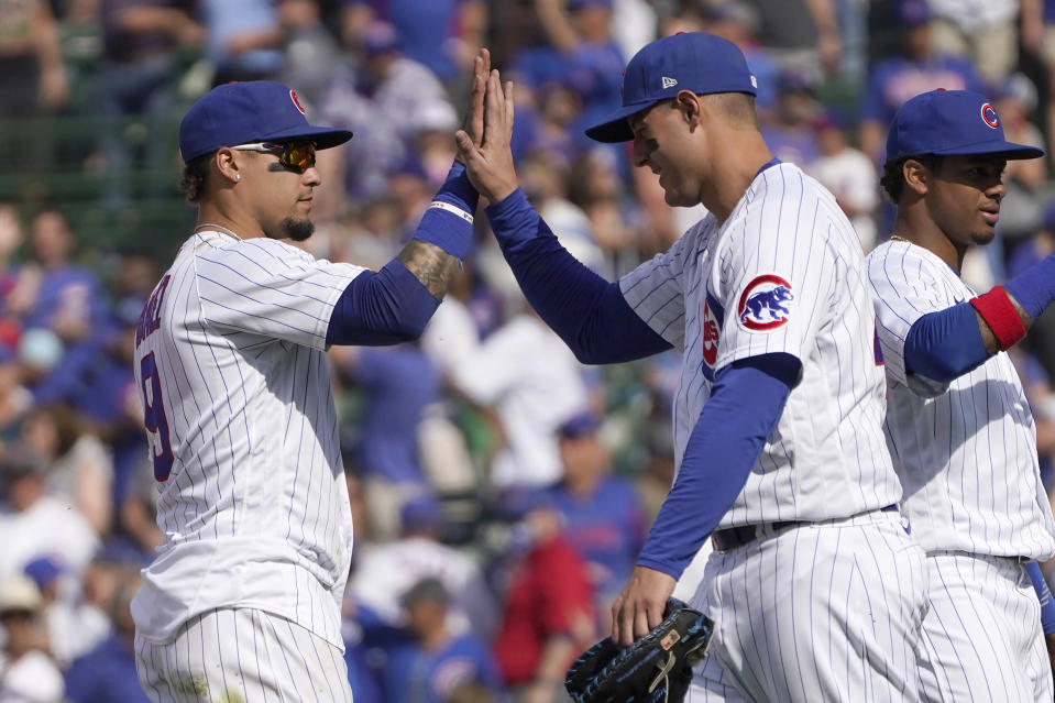 Chicago Cubs' Javier Baez, left, and Anthony Rizzo celebrate the team's 6-1 win and series sweep of the San Diego Padres following a baseball game Wednesday, June 2, 2021, in Chicago. (AP Photo/Charles Rex Arbogast)