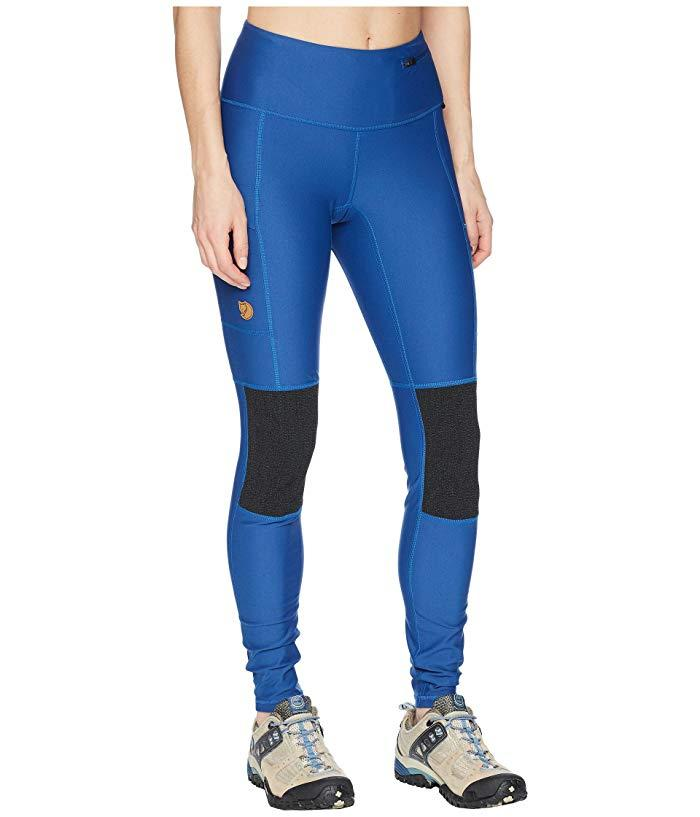 """<h3>Fjällräven Abisko Trek Tights </h3><br><br>This pricey pair of leggings is not playing around when it comes to serious storage ability —designed with durable reinforced panels, a densely knit nylon material that provides UPF 50 sun protection, and multiple zippered pockets to will hold your goods during the roughest treks.<br><br>As one reviewer raves, """"I've never paid this much for a pair of leggings but these are worth it. I've been living in them since I got them -- obviously on hikes, but also to lounge around the house and to go out, with tall boots and a long sweater over them.""""<br><br><strong>Fjällräven</strong> Abisko Trek Tights, $, available at <a href=""""https://go.skimresources.com/?id=30283X879131&url=https%3A%2F%2Fwww.zappos.com%2Fp%2Ffjallraven-abisko-trek-tights-deep-blue%2Fproduct%2F8912124%2Fcolor%2F32354"""" rel=""""nofollow noopener"""" target=""""_blank"""" data-ylk=""""slk:Zappos"""" class=""""link rapid-noclick-resp"""">Zappos</a>"""