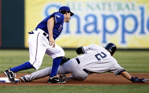 New York Yankees' Derek Jeter (2) safely steals second under the attempted tag of Texas Rangers' Ian Kinsler in the first inning of a baseball game on Wednesday, April 25, 2012, in Arlington, Texas. (AP Photo/Tony Gutierrez)