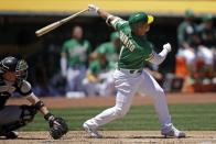 Oakland Athletics' Franklin Barreto swings for a three-run home run off Chicago White Sox pitcher Ross Detwiler in the first inning of a baseball game Saturday, July 13, 2019, in Oakland, Calif. (AP Photo/Ben Margot)