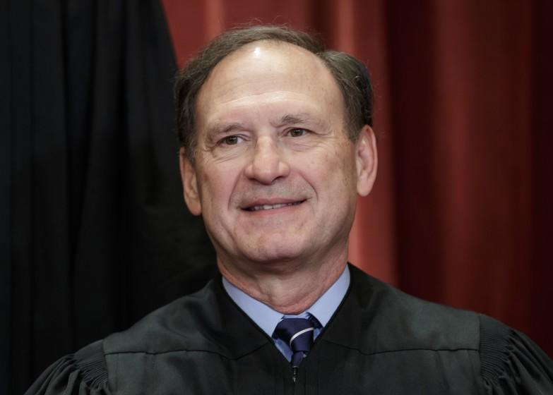 Associate Justice Samuel Alito Jr., nominated by President George W. Bush, sits with fellow Supreme Court justices for a group portrait at the Supreme Court Building in Washington, Friday, Nov. 30, 2018. (AP Photo/J. Scott Applewhite)