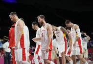 Spain players walk off the court after their loss in the men's basketball quarterfinal game against United States of America at the 2020 Summer Olympics, Tuesday, Aug. 3, 2021, in Saitama, Japan. (AP Photo/Eric Gay)