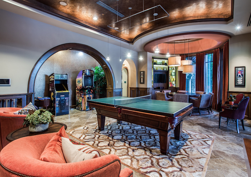 The game room with billiards and arcade.