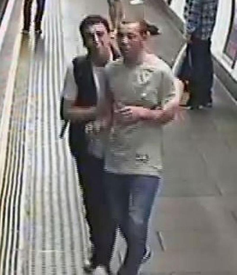 British Transport Police handout CCTV image of two men they will like to speak to following an incident where gas was released on board a train carriage at Oxford Circus station in London
