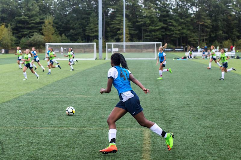 High school senior Precious Ogu plays soccer.