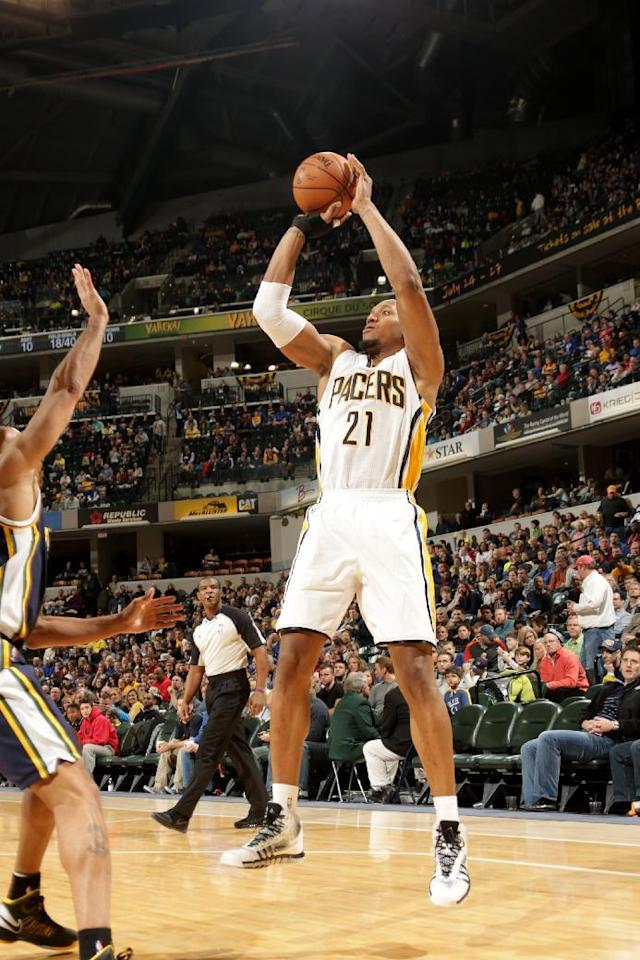 INDIANAPOLIS - MARCH 2: David West #21 of the Indiana Pacers shoots against the Utah Jazz at Bankers Life Fieldhouse on March 2, 2014 in Indianapolis, Indiana. (Photo by Ron Hoskins/NBAE via Getty Images)