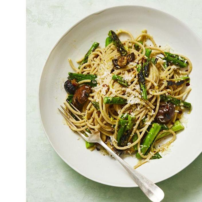 """<p>Pasta is a great go-to when you are rushing to get a meal on the table, but that doesn't mean it can't be packed with some protein. Add grilled veggies and scallions to give classic spaghetti more flavor and nutrients. </p><p><em><a href=""""https://www.womansday.com/food-recipes/a32699458/whole-wheat-spaghetti-with-grilled-asparagus-and-scallions-recipe/"""" rel=""""nofollow noopener"""" target=""""_blank"""" data-ylk=""""slk:Get the Whole-Wheat Spaghetti with Grilled Asparagus and Scallions recipe."""" class=""""link rapid-noclick-resp"""">Get the Whole-Wheat Spaghetti with Grilled Asparagus and Scallions recipe. </a></em> </p>"""