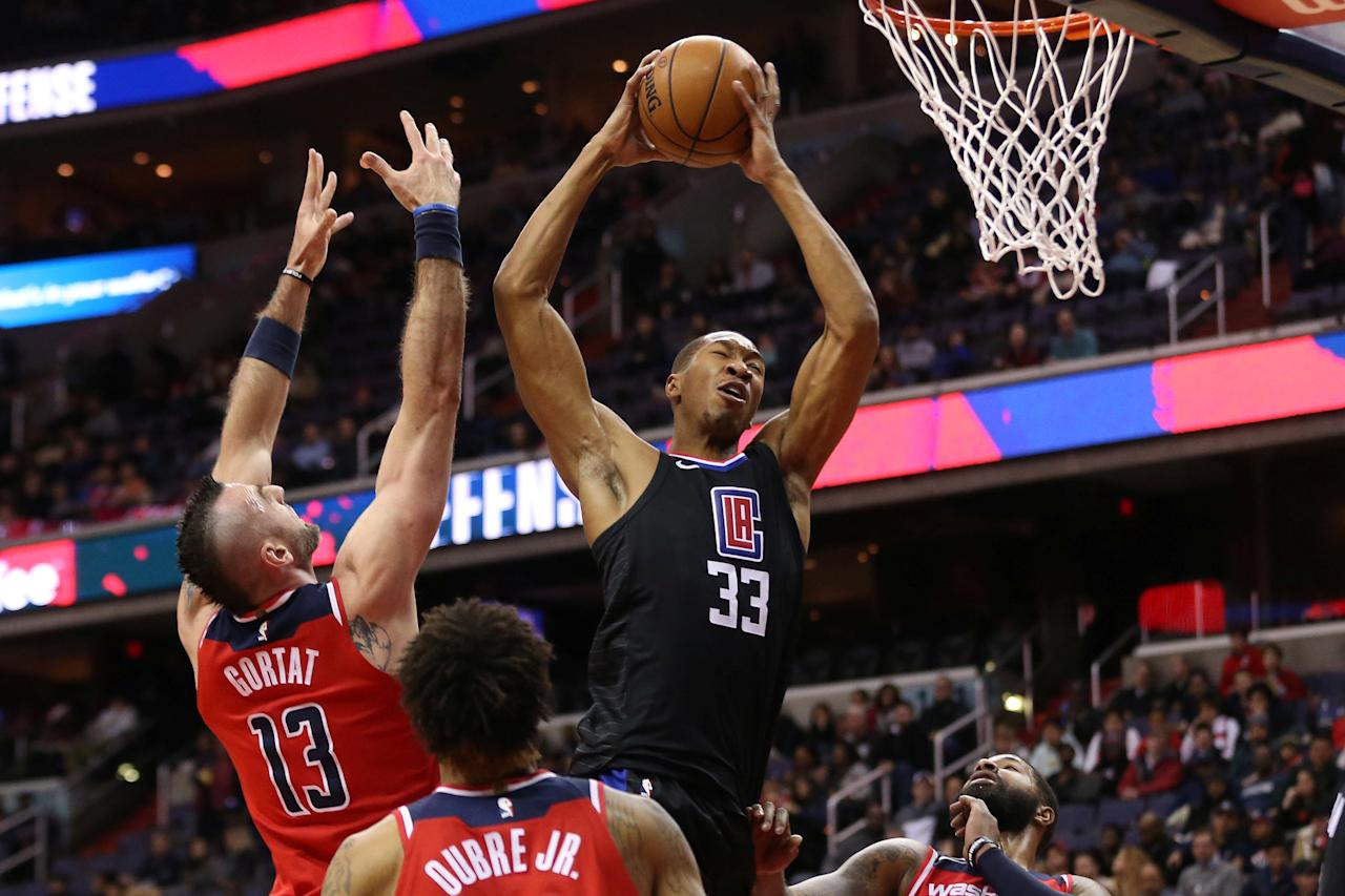 Dec 15, 2017; Washington, DC, USA; Los Angeles Clippers forward Wesley Johnson (33) grabs a rebound in front of Washington Wizards center Marcin Gortat (13) in the first quarter at Capital One Arena. Mandatory Credit: Geoff Burke-USA TODAY Sports     TPX IMAGES OF THE DAY